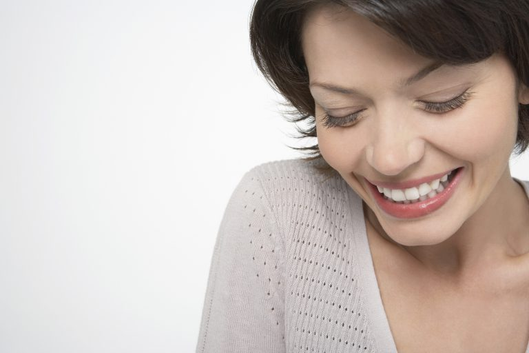 Woman Looking Down and Smiling